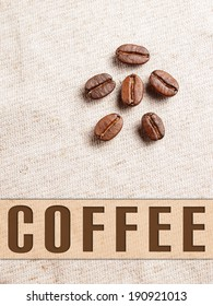 Roasted Coffee Beans on fabric textile with coffee text banner