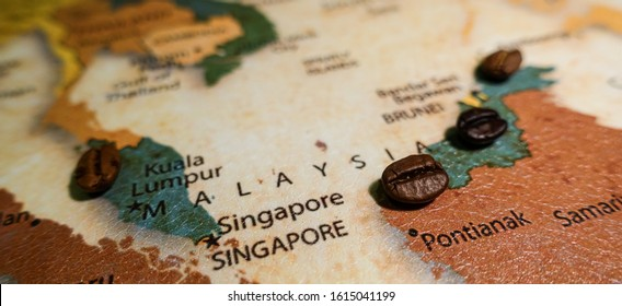 Roasted coffee beans on a map of Malaysia.