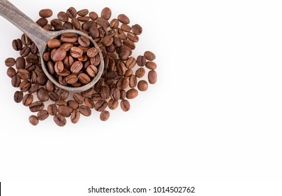 Roasted coffee beans on white background - Coffea