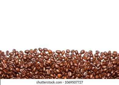 Roasted coffee beans on the white background.