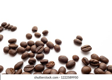 Roasted coffee beans on white background. Close-up image.