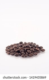 Roasted coffee beans pile on white background