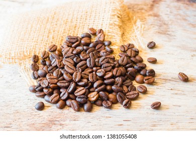 Roasted coffee beans placed on aold wooden table