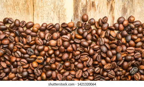 Roasted coffee beans Put together on a wooden table with copy space,coffee background