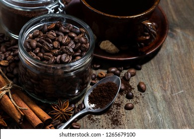 roasted coffee beans and spices on wooden background, concept photo, closeup horizontal