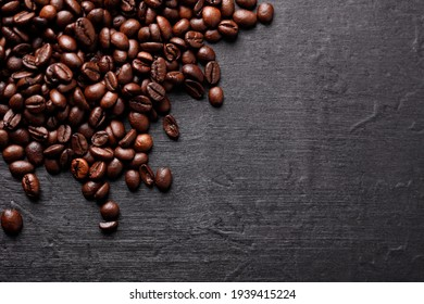 Roasted coffee beans, top view of coffee beans. Roasted coffee beans background