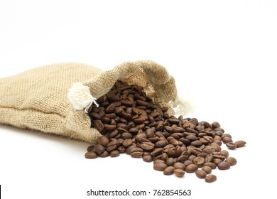 It is roasted coffee beans in white background.