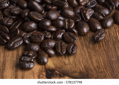 roasted coffee beans  wood background