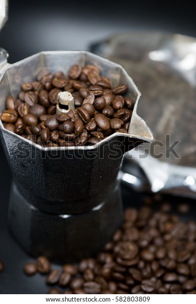 Roasted Coffee seed arabic from Ethiopia in Coffee pot on black background