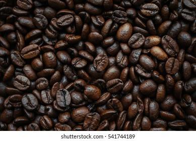 Roasted coffeee beans close-up withour background. Top view.