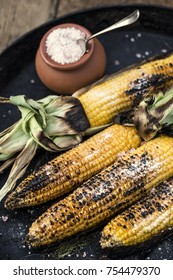 Roasted corn salted. Garden grill