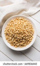 Roasted Crunchy Jowar - Indian Dietary Supplement, served in a white bowl over moody background, selective focus