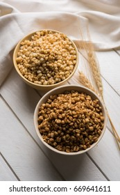 Roasted Crunchy Wheat and Jowar - Indian Dietary Supplement, served in a white bowl over moody background, selective focus