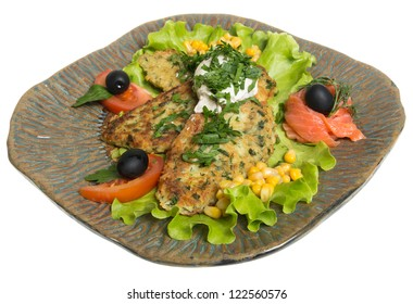 Roasted cutlets of potato with salmon on a plate