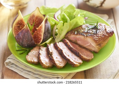 Roasted duck breast with figs, rosemary and salad