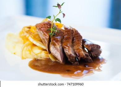 Roasted duck with mashed potatoes, caramelized fennel and orange salad and white wine sauce