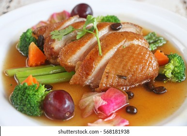 Roasted duck with mix vegetable and coffee bean soup