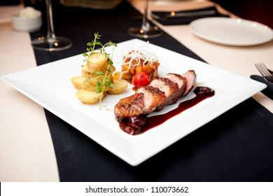 Roasted duck with pear,marinated in red wine and mascarpone rose