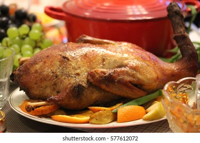 Roasted Duck Stuffed with Apples and Oranges.