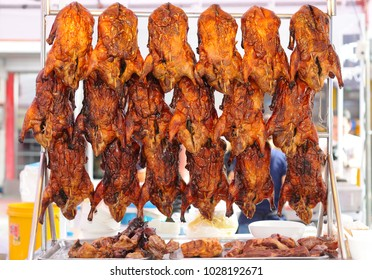 Roasted Ducks on Sale in a Street Market