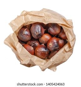 Roasted edible sweet chestnuts in paper bag isolated on white background. Top view.