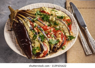 Roasted eggplant fan with mozzarella, tomatoes and parsley.