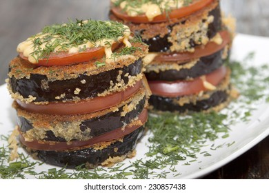 Roasted eggplant gratin with tomatoes layers, cheese and dill.