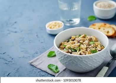 Roasted eggplant pine nuts mint barley salad. toning. selective focus