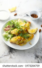 Roasted fish with almond and salad