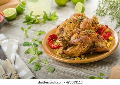 Roasted French baby Chicken - Coquelet, with hebs and grilled corn, fresh lime lemonade