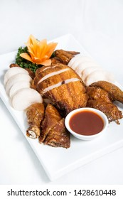 Roasted fried chicken cantonese with crackers and tauco sauce