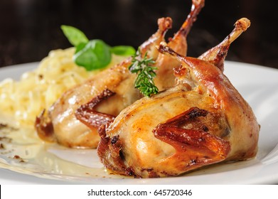 Roasted or fried quail with herbs and tagliatelle