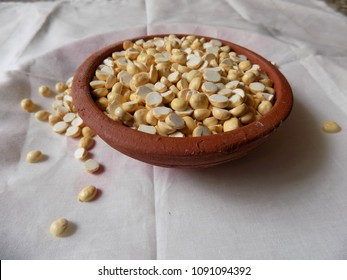 Roasted gram in a bowl and pot. Grain and Pulses texture and background. Chana is used for chatni and in a masala items in india