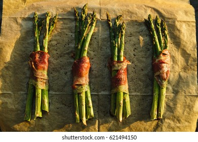 Roasted green asparagus wrapped in Spanish ham in the evening sun.