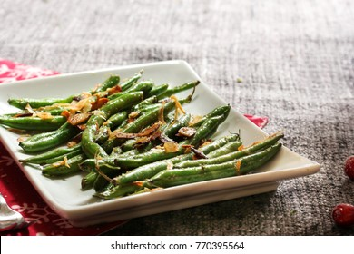 Roasted Green Beans topped with fried shallots and almonds, selective focus