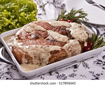 Roasted ham with mustard sauce, rosemary and cherry tomato.
