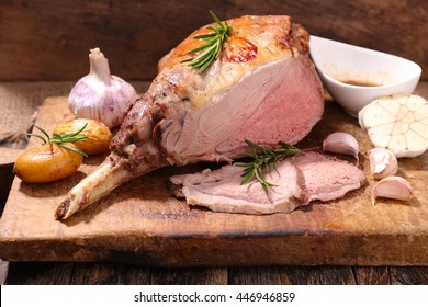 roasted lamb leg on wooden board
