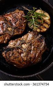 Roasted lamb loin chops with rosemary and garlic on iron pan