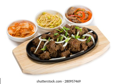 Roasted lamb with onions in a skillet and salads heh. From a series of Food Korean cuisine.