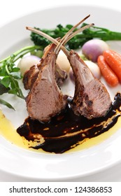 roasted lamb rib chops on a white background