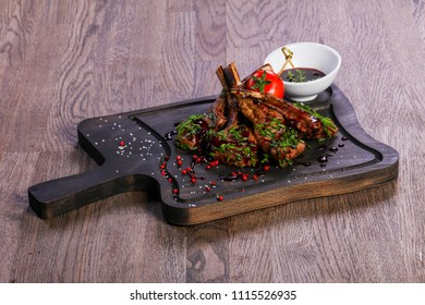 Roasted lamb ribs with sauce