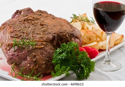 Roasted leg of lamb, potatoes and wine