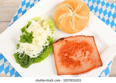 roasted meat loaf with coleslaw on a plate
