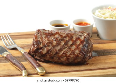 roasted meat on a cutting board. isolated object
