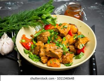 Roasted meat with potatoes, ojaxuri, traditional Georgian food. Selective focus.