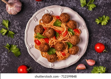 Roasted  meatballs with spaghetti. Top view, copy space.