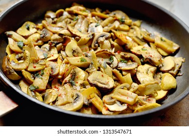 Roasted mushrooms champignons on stone table
