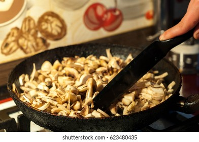 roasted mushrooms with onion in a pan