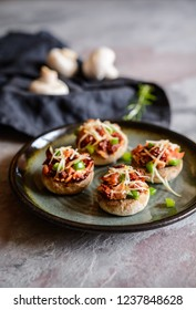 Roasted mushrooms stuffed with sliced ham, sun dried tomato and green bell pepper