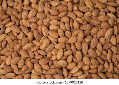 Roasted peeled almond nuts texture ,top view.Almond nuts background.